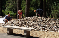 Exploring the rock pile in the rock garden of the Rice Northwest Museum of Rocks and Minerals.