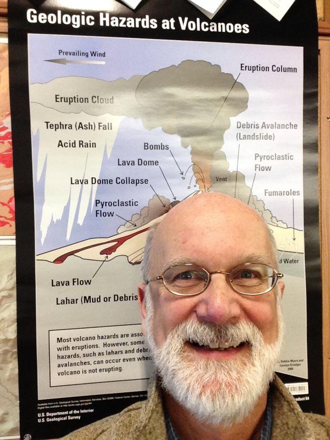 Rice NW Museum Director Julian Gray with USGS Volcanic Hazards poster