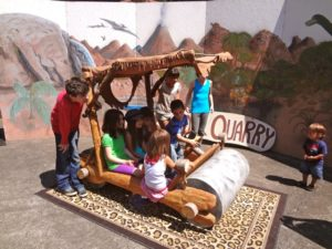 Posing in the Flintstone Mobile at the Rice Museum of Rocks and Minerals (6)