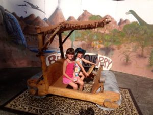 Posing in the Flintstone Mobile at the Rice Museum of Rocks and Minerals (7)