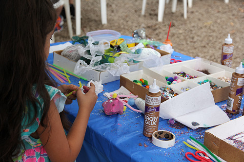 Summer Fest 2015 Young Girl decorates rocks in Kids Corner at the Rice Northwest Museum.