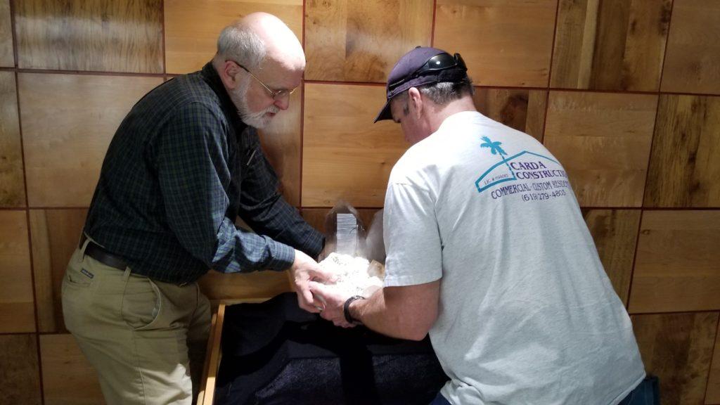 Placing a large topaz specimen on exhibit